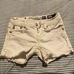 white miss me shorts .